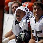 Cleveland Browns offensive guard Shawn Lauvao, left, watches from the bench with center Alex Mack during an NFL football game against the Philadelphia Eagles Sunday, Sept. 9, 2012, in Clevel …