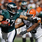 Philadelphia Eagles tight end Brent Celek (87) pushes away Cleveland Browns linebacker Craig Robertson in the third quarter of an NFL football game Sunday, Sept. 9, 2012, in Cleveland. The E …