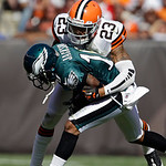 Cleveland Browns cornerback Joe Haden (23) tackles Philadelphia Eagles wide receiver DeSean Jackson (10) after a catch in the fourth quarter of an NFL football game Sunday, Sept. 9, 2012, in …