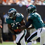 Philadelphia Eagles running back LeSean McCoy (25) takes the handoff from quarterback Michael Vick in an NFL football game against the Cleveland Browns Sunday, Sept. 9, 2012, in Cleveland. ( …
