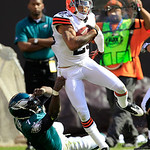 Cleveland Browns defensive back Joe Haden (23) is tackled by Philadelphia Eagles quarterback Michael Vick (7) after intercepting the ball in the third quarter of an NFL football game on Sund …