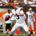 Cleveland Browns quarterback Brandon Weeden drops to pass against the Philadelphia Eagles in the second quarter of an NFL football game Sunday, Sept. 9, 2012, in Cleveland. (AP Photo/Ron Sch …