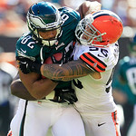Cleveland Browns linebacker Kaluka Maiava (56) stops Philadelphia Eagles tight end Clay Harbor (82) during an NFL football game Sunday, Sept. 9, 2012, in Cleveland. (AP Photo/Tony Dejak)