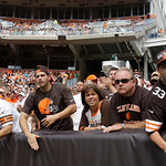 Cleveland Browns fans watch during an NFL football game against the Philadelphia Eagles Sunday, Sept. 9, 2012, in Cleveland. (AP Photo/Tony Dejak)