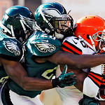 Cleveland Browns' Josh Cribbs, right, is wrapped up by Philadelphia Eagles' Jaiquawn Jarrett, center, and Brandon Boykin on a kick return in the fourth quarter of an NFL football game, Sunda …