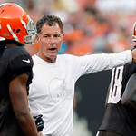 Cleveland Browns coach Pat Shurmur talks with wide receiver Owen Spencer, left, during NFL football training camp in Cleveland on Wednesday Aug. 8, 2012. (AP Photo/Ron Schwane)