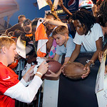 Cleveland Browns quarterback Brandon Weeden signs autographs for fans after NFL football training camp in Cleveland on Wednesday Aug. 8, 2012. (AP Photo/Ron Schwane)