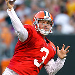 Cleveland Browns quarterback Brandon Weeden throws a pass during an NFL football training camp in Cleveland, Wednesday, Aug. 8, 2012. (AP Photo/Ron Schwane)