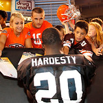 Cleveland Browns running back Montario Hardesty signs autographs for fans after an NFL football training camp in Cleveland, Wednesday, Aug. 8, 2012. (AP Photo/Ron Schwane)