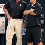 Cleveland Browns owner Jimmy Haslam, left, talks with general manager Tom Heckert during Family Night at Cleveland Browns Stadium during an NFL football training camp in Cleveland, Wednesday …