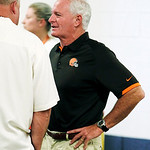 Cleveland Browns owner Jim Haslam talks with team president Mike Holmgren upon arriving at the team's stadium for Family Fun Night during an NFL football training camp in Cleveland, Wednesda …