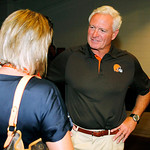 Cleveland Browns owner Jimmy Haslam talks with a fan during Family Night at Cleveland Browns Stadium at an NFL football training camp in Cleveland, Wednesday, Aug. 8, 2012. (AP Photo/Ron Sch …