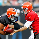 Cleveland Browns quarterback Colt McCoy, right, hands off to fullback Brad Smelley during an NFL football training camp in Cleveland, Wednesday, Aug. 8, 2012. (AP Photo/Ron Schwane)