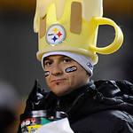 A Pittsburgh Steelers fan makes his way to his seat during the NFL football game against the Cleveland Brownson Thursday, Dec. 8, 2011 in Pittsburgh. (AP Photo/Don Wright)