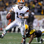 Cleveland Browns quarterback Colt McCoy (12) is chased out of the pocket by Pittsburgh Steelers strong safety Troy Polamalu in the fourth quarter of an NFL football game Thursday, Dec. 8, 20 …