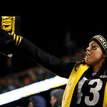 A Pittsburgh Steelers fan cheers during the third quarter of an NFL Football game between the Pittsburgh Steelers and Cleveland Browns Thursday, Dec. 8, 2011, in Pittsburgh. Pittsburgh won 1 …