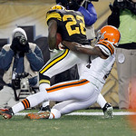 Pittsburgh Steelers cornerback William Gay (22) is tackled by Cleveland Browns wide receiver Mohamed Massaquoi (11) after intercepting a pass in the fourth quarter of the NFL football game o …
