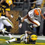 Cleveland Browns wide receiver Jordan Norwood (10) hops over Pittsburgh Steelers cornerback William Gay (22) after Gay broke up a pass in the second quarter of the NFL football game on Thurs …