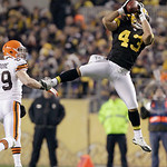 Pittsburgh Steelers strong safety Troy Polamalu (43) makes an interception in front of Cleveland Browns tight end Evan Moore (89) in the second quarter of the NFL football game on Thursday,  …