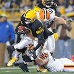 Pittsburgh Steelers quarterback Ben Roethlisberger (7) is tackled by Cleveland Browns' Scott Paxson, bottom, and Brian Schaefering (91) during the second quarter of an NFL football game  in  …