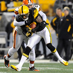 Pittsburgh Steelers wide receiver Mike Wallace (17) front, is hit by Cleveland Browns cornerback Sheldon Brown (24) after making a catch in the first quarter of the NFL football game on Thur …