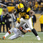 Pittsburgh Steelers tight end David Johnson (85) tries to get away from Cleveland Browns free safety Mike Adams (20) after making a catch in the NFL football game on Thursday, Dec. 8, 2011, …