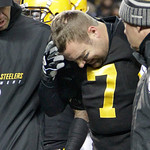 Pittsburgh Steelers quarterback Ben Roethlisberger (7) winces as he is helped from the field after being injured in the second quarter of the NFL football game against the Cleveland Browns o …