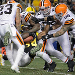 Pittsburgh Steelers running back Rashard Mendenhall (34) is swarmed by the Cleveland Browns defense as he tries to run the ball in the second quarter of an NFL football game Thursday, Dec. 8 …