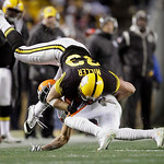 Pittsburgh Steelers tight end Heath Miller (83) is upended after making  a catch against the Cleveland Browns in the NFL football game on Thursday, Dec. 8, 2011, in Pittsburgh. (AP Photo/Gen …