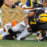 Pittsburgh Steelers quarterback Ben Roethlisberger (7) is injured as Cleveland Browns nose tackle Scott Paxson (69) in the second quarter of the NFL football game on Thursday, Dec. 8, 2011,  …