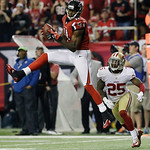 Atlanta Falcons' Julio Jones (11) catches a pass in front of San Francisco 49ers' Tarell Brown (25) during the first half of the NFL football NFC Championship game Sunday, Jan. 20, 2013, in  …