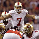 San Francisco 49ers quarterback Colin Kaepernick signals to the line during the second half of the NFL football NFC Championship game Sunday, Jan. 20, 2013, in Atlanta. (AP Photo/David Goldm …