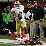 San Francisco 49ers' Colin Kaepernick runs past Atlanta Falcons' Kroy Biermann during the first half of the NFL football NFC Championship game Sunday, Jan. 20, 2013, in Atlanta. (AP Photo/Da …