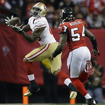 San Francisco 49ers' Vernon Davis catches a pass in front of Atlanta Falcons' Stephen Nicholas (54) during the second half of the NFL football NFC Championship game Sunday, Jan. 20, 2013, in …