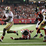 San Francisco 49ers' Frank Gore gets away from Atlanta Falcons' Jonathan Babineaux (95) for a five-yard touchdown run during the second half of the NFL football NFC Championship game Sunday, …
