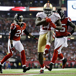 San Francisco 49ers' Frank Gore (21) breaks away for a nine-yard touchdown run during the second half of the NFL football NFC Championship game against the San Francisco 49ers Sunday, Jan. 2 …