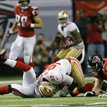 San Francisco 49ers' Aldon Smith recovers a fumble in front of Atlanta Falcons' Matt Ryan during the second half of the NFL football NFC Championship game Sunday, Jan. 20, 2013, in Atlanta.  …