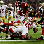 Atlanta Falcons' Stephen Nicholas (54) tries to grab the ball after it was stripped by Dunta Robinson (23) from San Francisco 49ers' Michael Crabtree (15) during the second half of the NFL f …