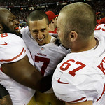 San Francisco 49ers' Colin Kaepernick (7) celebrates with Leonard Davis and Daniel Kilgore (67) after the NFL football NFC Championship game against the Atlanta Falcons Sunday, Jan. 20, 2013 …