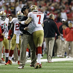 San Francisco 49ers head coach Jim Harbaugh celebrates with Colin Kaepernick (7) after a touchdown during the second half of the NFL football NFC Championship game against the Atlanta Falcon …