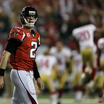 Atlanta Falcons' Matt Ryan walks off the field as the San Francisco 49ers celebrate after the NFL football NFC Championship game Sunday, Jan. 20, 2013, in Atlanta. The 49ers won 28-24 to adv …