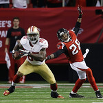 San Francisco 49ers' Vernon Davis catches a pass in front of Atlanta Falcons' Thomas DeCoud during the first half of the NFL football NFC Championship game Sunday, Jan. 20, 2013, in Atlanta. …