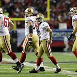 San Francisco 49ers kicker David Akers, second right, walks off the field after missing a field goal during the second half of the NFL football NFC Championship game against the Atlanta Falc …