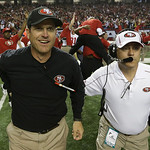 San Francisco 49ers head coach Jim Harbaugh runs onto the field with an assistant after the NFL football NFC Championship game against the Atlanta Falcons Sunday, Jan. 20, 2013, in Atlanta.  …