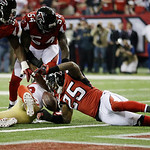 San Francisco 49ers' Michael Crabtree (15) looses the ball during the second half of the NFL football NFC Championship game against the Atlanta Falcons Sunday, Jan. 20, 2013, in Atlanta. The …