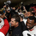 The San Francisco 49ers celebrate with head coach Jim Harbaugh, center, after the NFL football NFC Championship game against the Atlanta Falcons Sunday, Jan. 20, 2013, in Atlanta. The 49ers  …