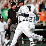 Detroit Tigers' Carlos Guillen crosses home plate in front of umpire Brian Gorman to score the winning run on wild pitch by Cleveland Indians' Chris Perez in the ninth inning of a baseball g …