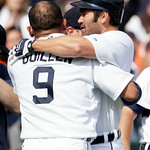 Detroit Tigers' Carlos Guillen (9) is hugged by teammate Johnny Damon after scoring the game-winning run on a wild pitch from Cleveland Indians' Chris Perez in the ninth inning of a baseball …
