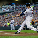 Minnesota Twins' Justin Morneau delivers an RBI double off Cleveland Indians pitcher Justin Masterson in the first inning of a baseball game Tuesday, April 20, 2010 in Minneapolis. Catching, …