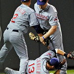 Cleveland Indians third baseman Jhonny Peralta, left, left fielder Austin Kearns, right, and shortstop Asdrubal Cabrera, bottom, collide during an unsuccessful attempt to catch a foul ball o …
